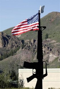 The U.S. flag flies atop a metal sculpture of an M-16 assault rifle outside Ketchum, Idaho July 7, 2009. REUTERS/Rick Wilking