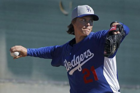 Los Angeles Dodgers pitcher Zack Greinke throws a bullpen session during MLB Cactus League spring training at the team's facility in Glendal