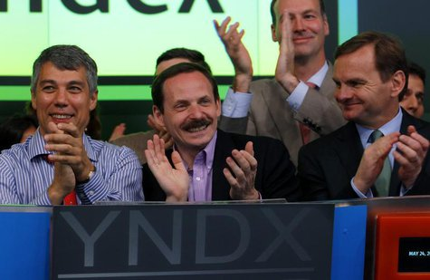 Yandex founder and CEO Arkady Volozh (C) celebrates as Yandex is listed on the Nasdaq Stock Exchange during their IPO at the Nasdaq market s