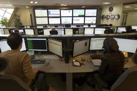 Technicians monitor data flow in the control room of an internet service provider in Tehran February 15, 2011. REUTERS/Caren Firouz