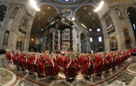 Cardinals attend a mass in St. Peter's Basilica at the Vatican March 12, 2013. REUTERS/Stefano Rellandini
