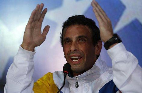 Venezuela's opposition leader and presidential candidate Henrique Capriles gestures during a news conference in Caracas March 11, 2013. REUT