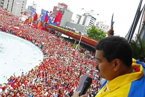 Venezuela's acting President, Nicolas Maduro, gestures to supporters after he registered as a candidate for president in the April 14th elec