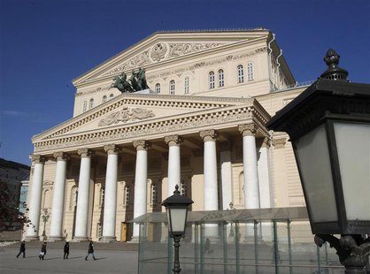 People walk past the main entrance to the Bolshoi Theatre in Moscow March 12, 2013. REUTERS/Sergei Karpukhin