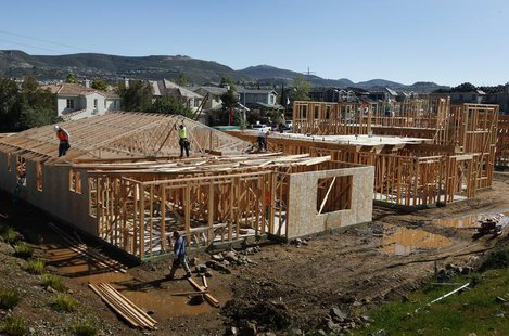 Construction workers build new homes at a development area in San Marcos, California March 20, 2012. REUTERS/Mike Blake