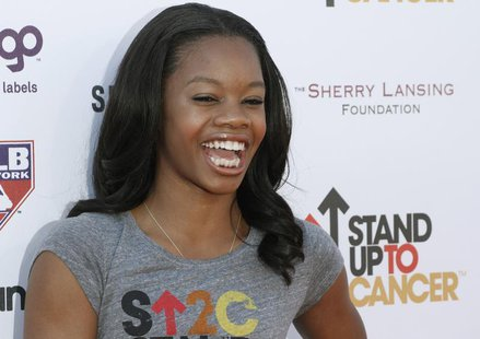 Olympic gold medal gymnast Gabrielle Douglas arrives for the Stand Up To Cancer fundraising telethon at the Shrine Auditorium in Los Angeles