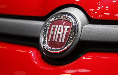 The Fiat logo is seen in a car displayed on the Fiat booth during the first media day of the Geneva Auto Show at the Palexpo in Geneva March