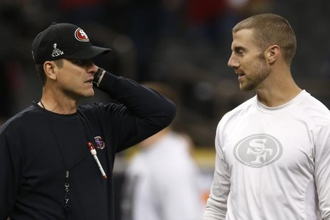 San Francisco 49ers head coach Jim Harbaugh (L) talks with quarterback Alex Smith during warm ups ahead of the NFL Super Bowl XLVII football