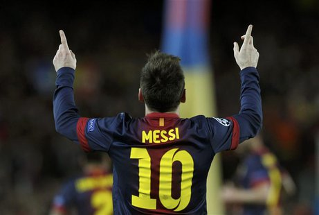 Barcelona's Lionel Messi celebrates after scoring his second goal against AC Milan during their Champions League round of 16 second leg socc