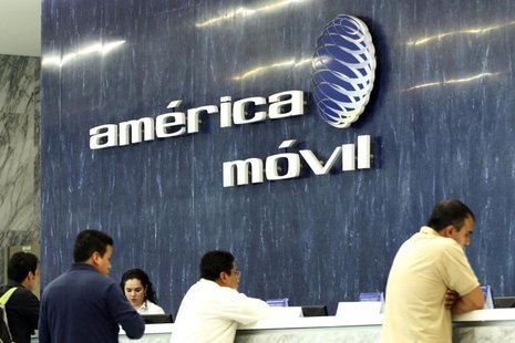 The logo of America Movil is seen on the wall of the reception area in the company's corporate offices in Mexico City February 13, 2013. REU