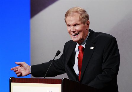 Democratic Senator Bill Nelson makes a point with Republican Representative Connie Mack IV (not pictured) during their U.S. Senate debate in