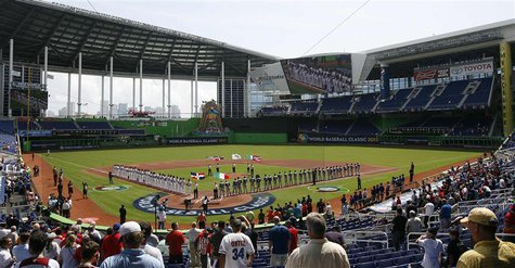 Players from Dominican Republic (L) and Italy (R) line up before their 2013 World Baseball Classic game at Marlins Stadium in Miami, Florida