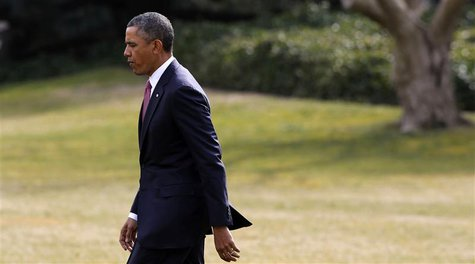 U.S. President Barack Obama walks on the South Lawn of the White House in Washington before departing to visit wounded military personnel at