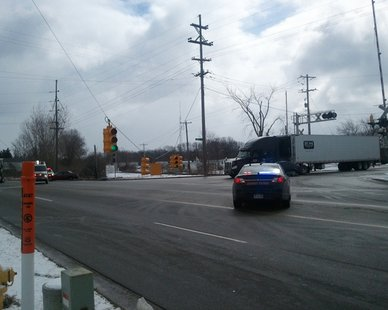 Traffic signals were hanging low at the intersection of Lakewood Boulevard and Roost Avenue on Holland's North Side following a noontime crash on Mar. 13, 2013. No injuries were reported.