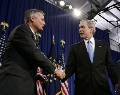 Former President George W. Bush (R) shakes hands with Republican Congressman Chris Chocola (R-IN) in Mishawaka, Indiana February 23, 2006. R