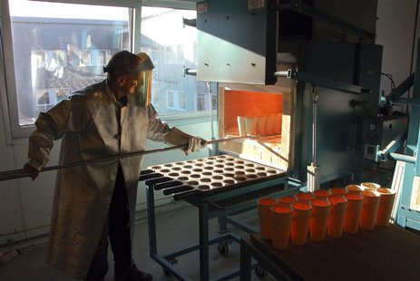 Doctor Adrian Berisha, lab manager at Activation laboratories, prepares samples of mines to check ore grades of minerals in Nuuk in this Oct