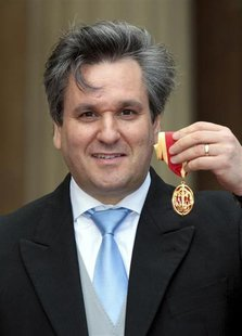 Royal Opera House Music Director, Antonio Pappano, poses with his Knighthood after being knighted by Britain's Prince Charles at Buckingham