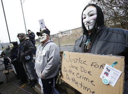 A small group of people take part in a protest outside the Juvenile Court building in Steubenville, Ohio, March 13, 2013. REUTERS/Jason Cohn