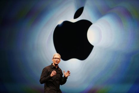 Apple Inc. CEO Tim Cook takes the stage during Apple Inc.'s iPhone media event in San Francisco, California September 12, 2012. REUTERS/Beck