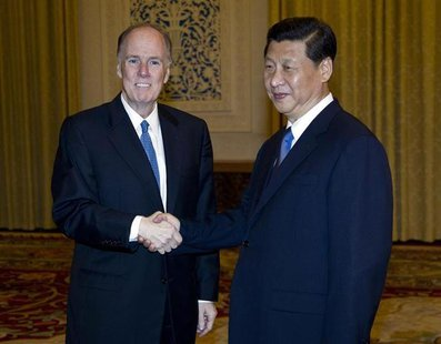 National Security Advisor Tom Donilon (L) shakes hands with China's Vice President Xi Jinping before a meeting at the Great Hall of the Peop