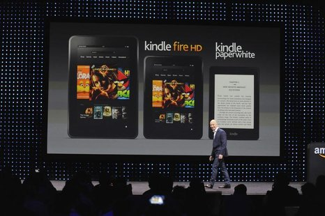 "Amazon CEO Jeff Bezos walks off after unveiling the Kindle Paperwhite, Kindle Fire HD 8.9"" and 7"" during Amazon's Kindle Fire event in Santa"
