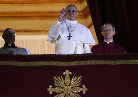 Newly elected Pope Francis, Cardinal Jorge Mario Bergoglio of Argentina appears on the balcony of St. Peter's Basilica after being elected b