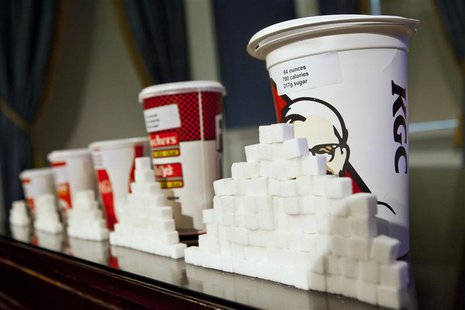 A 64-ounce drink is displayed alongside other soft drink cup sizes at a news conference at City Hall in New York, May 31, 2012. REUTERS/Andr