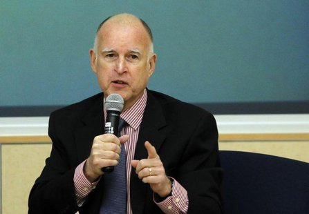 California Governor Jerry Brown gestures while addressing the audience during a summit meeting on the future of housing in California, in Oa