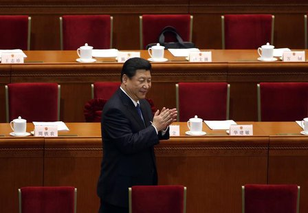 China's Communist Party Chief Xi Jinping arrives for a plenary session of the National People's Congress (NPC) at the Great Hall of the Peop