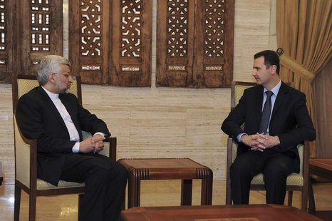 Syria's President Bashar al-Assad (R) meets Iran's Supreme National Security Council Secretary Saeed Jalili in Damascus February 3, 2013, in