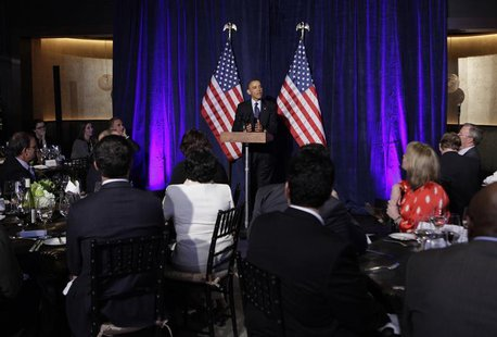 U.S. President Barack Obama delivers remarks at the Organizing for Action dinner in Washington, March 13, 2013. REUTERS/Yuri Gripas