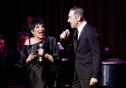 Singer Liza Minnelli and actor Alan Cumming perform during their one night only performance in New York, March 13, 2013. REUTERS/Carlo Alleg