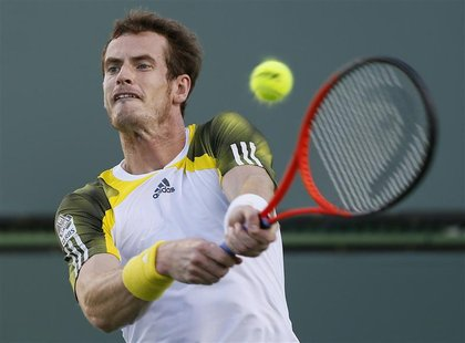 Andy Murray of Britain returns a shot against Carlos Berlocq of Argentina during their match at the BNP Paribas Open ATP tennis tournament i