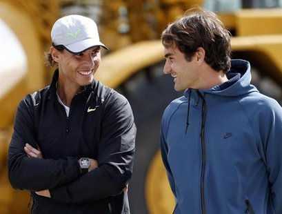 Rafael Nadal (L) of Spain and Roger Federer of Switzerland talk during a ground-breaking for the expansion of the Indian Wells Tennis Garden