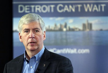 Michigan Governor Rick Snyder talks about the city of Detroit being in a financial emergency state during a meeting with an invited audience
