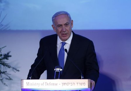 Israel's Prime Minister Benjamin Netanyahu speaks during a farewell event for outgoing Defence Minister Ehud Barak at Bar-Ilan University ne