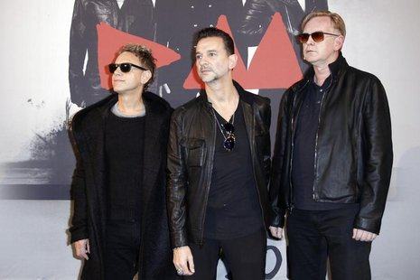 From L-R, Martin Gore, Dave Gahan and Andrew Fletcher of British band Depeche Mode pose during a photocall before a press conference in Pari