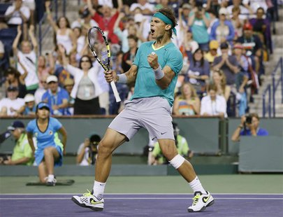 Rafael Nadal of Spain celebrates defeating Ernests Gulbis of Latvia during the third set of their men's singles match at the BNP Paribas Ope