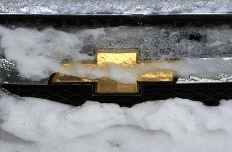 A Chrysler logo seen on the radiator grill of a vehicle covered with snow and ice in Bucharest February 10, 2012. REUTERS/Radu Sigheti