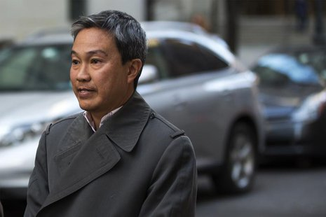 Tai Nguyen, president of Insight Research LLC, departs the Manhattan Federal Courthouse after a sentencing hearing regarding his pleading gu
