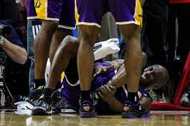 Kobe Bryant injures left ankle during the end of a 96-92 loss to the Atlanta Hawks Wednesday night.