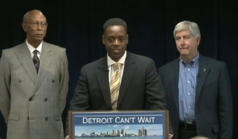 Kevyn Orr stands before a press conference flanked by Detroit Mayor Dave Bing and Governor Rick Snyder.