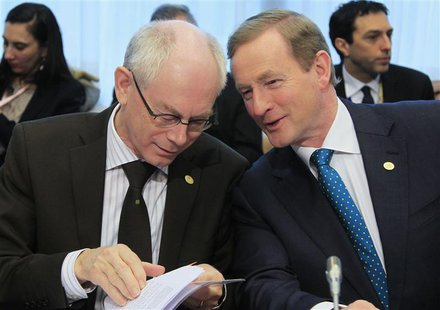 European Council President Herman Van Rompuy (L) talks with Ireland's Prime Minister Enda Kenny at the start of a Tripartite Social Summit a