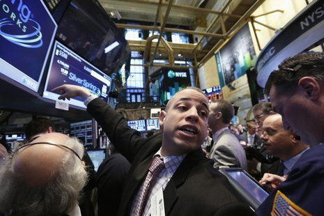 A trader gestures while waiting for Silver Spring Networks to begin trading on the floor at the New York Stock Exchange, March 13, 2013. REU