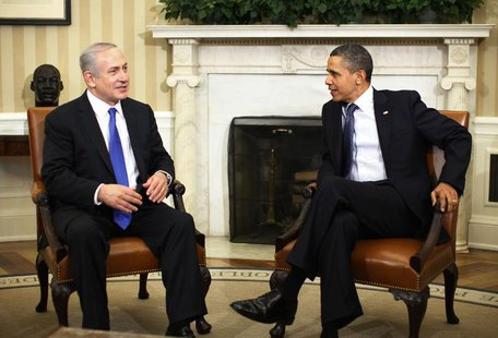 U.S. President Barack Obama welcomes Israeli Prime Minister Benjamin Netanyahu inside the Oval Office of the White House in Washington, Marc
