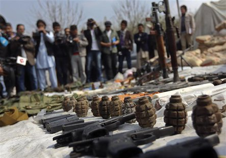 Weapons and ammunition seized from captured suspected Taliban are presented to the media at the National Directorate of Security (NDS) headq