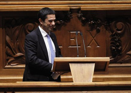 Portugal's Finance Minister Vitor Gaspar reacts in parliament, during the presentation of the 2013 state budget, in Lisbon November 27, 2012
