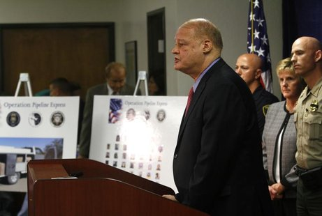 "Arizona Attorney General Tom Horne speaks about weapons and drugs seized from the Mexican Sinaloa cartel during ""Operation Pipeline Express"""