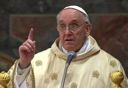 Newly elected Pope Francis I, Cardinal Jorge Mario Bergoglio of Argentina, leads a a mass with cardinals at the Sistine Chapel, in a still i