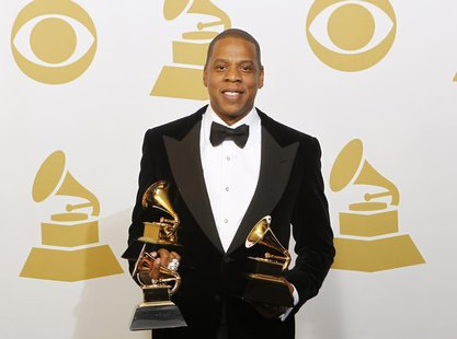 Jay-Z poses with the awards he won for Best Rap Performance, Best Rap/Sung Collaboration and Best Rap Song backstage at the 55th annual Gram